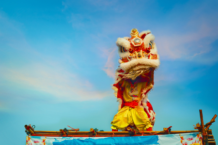 BANGKOK, THAILAND - FEBRUARY 20: A group of people perform a lion dance during Chinese new years celebration Editorial