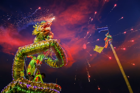 BANGKOK, THAILAND - FEBUARY 20: A group of people perform a dragon dance during Chinese new years celebration