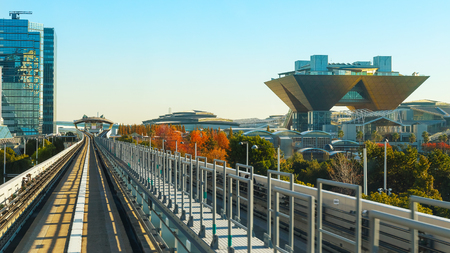 Motion blur of train moving inside tunnel in Odaiba, Tokyo, Japan                                                          TOKYO, JAPAN - NOVEMBER 27 2015: Tokyo Big Sight -  the Tokyo International Exhibition Center from Yurikamome monorail sky train in