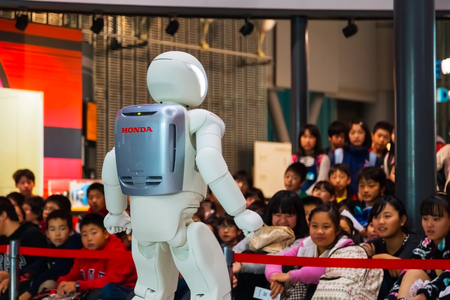 TOKYO, JAPAN - NOVEMBER 27 2015: Asimo, the humanoid robot created by Honda is presented at Miraikan, The National Museum of Emerging Science and Innovation in Odaiba area Editorial