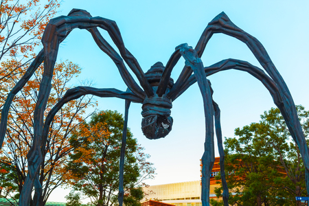 bourgeois: TOKYO, JAPAN - NOVEMBER 28 2015: Maman - a spider sculpture by Louise Bourgeois, situated at the base of Mori tower building in Roppongi Hills