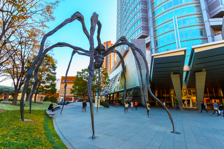TOKYO, JAPAN - NOVEMBER 28 2015: Maman - a spider sculpture by Louise Bourgeois, situated at the base of Mori tower building in Roppongi Hills