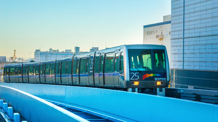 TOKYO, JAPAN - NOVEMBER 27 2015: Yurikamome train in Odaiba operated remotely with no conductor on board, crosses the Rainbow Bridge and passes through Odaiba, linking 16 stations in its 15km run Editorial