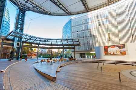mori: TOKYO, JAPAN - NOVEMBER 28 2015: T.V. Asahi building situated on the opposite side of Mori tower building in Roppongi Hills