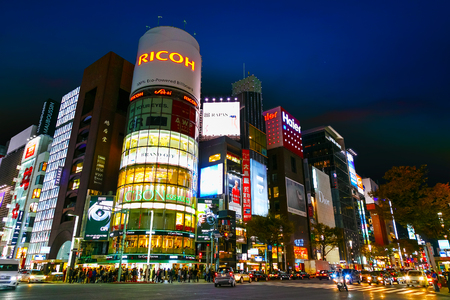 entertainment district: TOKYO, JAPAN - NOVEMBER 28 2015: The Ginza is the Tokyos most famous upmarket shopping, dining and entertainment district featuring numerous department stores, boutique, art galleries, restaurants and cafe