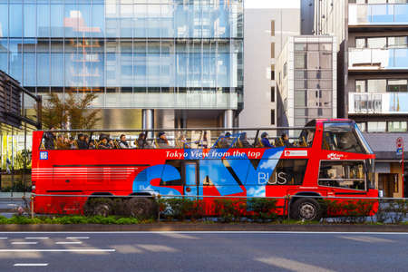 reminiscent: TOKYO, JAPAN - NOVEMBER 28 2015: SKYBUS TOKYO operates stylish red open-top double-decker vehicles reminiscent of the iconic buses of London. Its tours are perfect for short trips around Tokyo