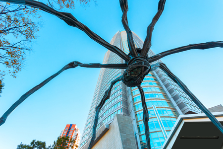 mori: TOKYO, JAPAN - NOVEMBER 28 2015: Maman - a spider sculpture by Louise Bourgeois, situated at the base of Mori tower building in Roppongi Hills