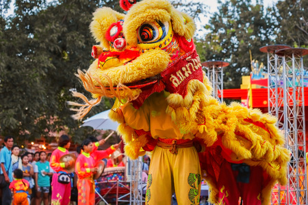 BANGKOK, THAILAND - JANUARY 14 2016: A group of people perform a lion dance during Chinese new years celebration