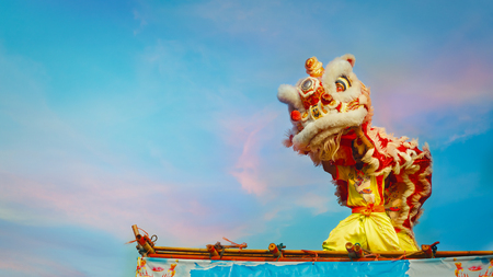 BANGKOK, THAILAND - FEBUARY 20: A group of people perform a lion dance during Chinese new years celebration