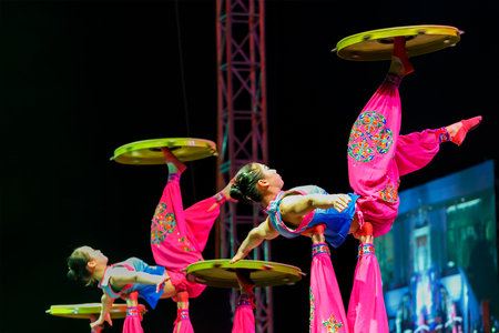 BANGKOK, THAILAND - FEBRUARY 20 2016: Jinan acrobatic troupe performing in Rama IX Park in a Chinese new year Celebration. The group is one of the best acrobatic performance in China