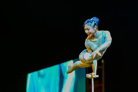 BANGKOK, THAILAND - FEBRUARY 20 2016: Jinan acrobatic troupe performing in Rama IX Park in a Chinese new year Celebration. The group is one of the best acrobatic performance in China Editorial