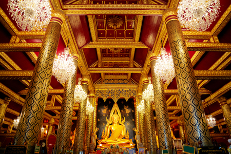 PHITSANULOK, THAILAND - NOVEMBER 4 2016: Phra Phuttha Chinnarat Buddha Image at Wat Phra Si Rattana Mahathat Temple, one of the three most highly respected Buddha images in Thailand Editorial
