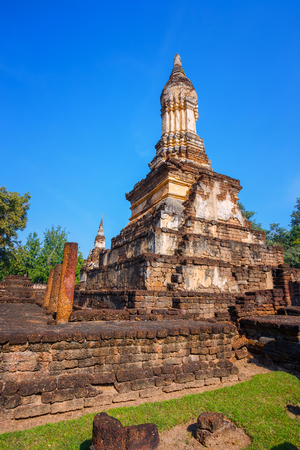 Wat Chedi Jet Thaew in the precinct of Si Satchanalai Historical Park, a UNESCO World Heritage Site in Thailand  SUKHOTHAI, THAILAND - JANUARY 17 2017: Wat Chedi Jet Thaew in the precinct of Si Satchanalai Historical Park, a UNESCO World Heritage Site in  Editorial