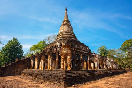 Wat Chang Lom Temple at Si Satchanalai Historical Park, a UNESCO world heritage site in Sukhothai, Thailand   SUKHOTHAI, THAILAND - JANUARY 17 2017: Wat Chang Lom Temple at Si Satchanalai Historical Park, a UNESCO world heritage site