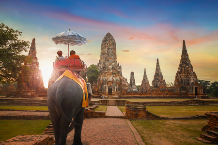 Tourist With Elephant at Wat Chaiwatthanaram temple in Ayuthaya Historical Park, a UNESCO world heritage site, Thailand