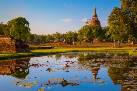 Wat Mahathat Temple in the precinct of Sukhothai Historical Park, a UNESCO World Heritage Site in Thailand  SUKHOTHAI, THAILAND - JANUARY 16 2017: Wat Mahathat Temple in the precinct of Sukhothai Historical Park, a UNESCO world heritage site.