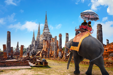 Tourist With Elephant at Wat Phra Si Sanphet Temple in Ayutthaya Historical Park, a UNESCO world heritage site, Thailand
