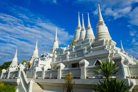 Elaborated white Buddhist Pagoda with multiple spires at Wat Asokara Temple in Thailand