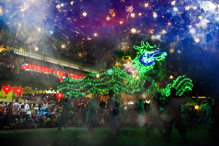 BANGKOK, THAILAND - JANUARY 17 2016: Dragon dance  performed for a lunar new year celebration at a Chinese shrine
