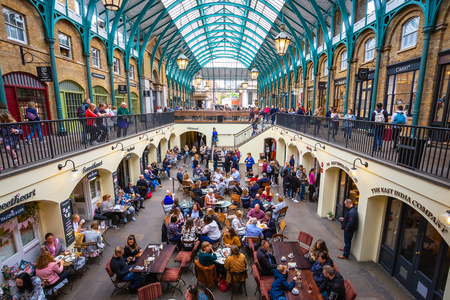 LONDON, UNITED KINGDOM - MAY 12 2018:  Covent Garden Market one of the most well known market and the most poppular tourist spot in London