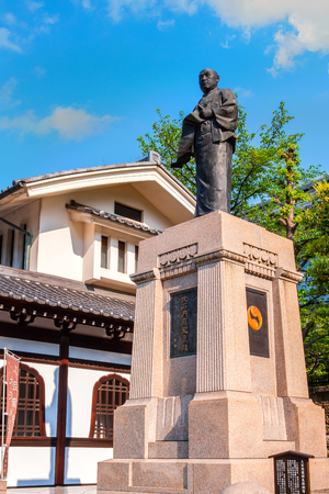 TOKYO, JAPAN - APRIL 20 2018: Statue of Oishi Kuranosuke, the leader of 47 loyal ronin, one of the most popular Japanese historical stories at Sengakuji Temple