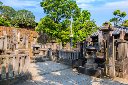 TOKYO, JAPAN - APRIL 20 2018: Grave Lord Ako (left) and lady Ako (right) masters of 47 ronin, loyal masterless samurai, one of the most popular Japanese historical epic legends at Sengakuji Temple