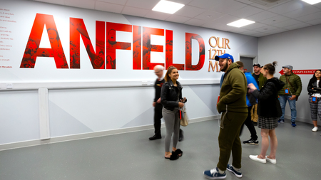 LIVERPOOL, UNITED KINGDOM - MAY 17 2018: LFC staffs and a group of its football fans take a tour in Anfield stadium, the home ground of Liverpool football club
