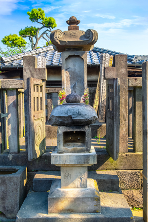 TOKYO, JAPAN - APRIL 20 2018: Grave of lady Ako master of 47 ronin, loyal masterless samurai, one of the most popular Japanese historical epic legends at Sengakuji Temple