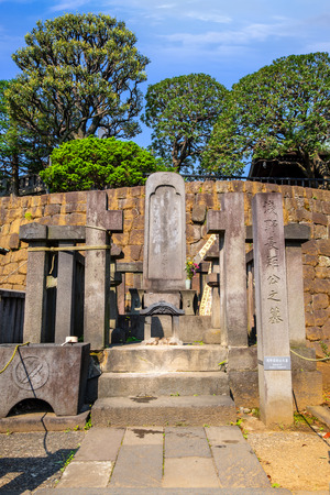 TOKYO, JAPAN - APRIL 20 2018: Grave Lord Ako, master of 47 ronin, loyal masterless samurai, one of the most popular Japanese historical epic legends at Sengakuji Temple