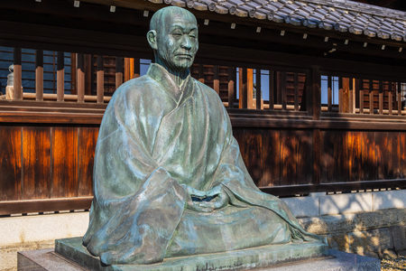 TOKYO, JAPAN - APRIL 20 2018: Statue of Sawaki Kodo Roshi, one of the leading and most influential Zen masters of the 20th century in Japan at Sengakuji Temple 報道画像