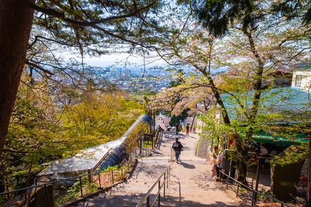 AIZUWAKAMATSU, JAPAN - APRIL 21 2018: Way up to The grave site of Byakkutai (White Tiger Force) at Mt. Iimori