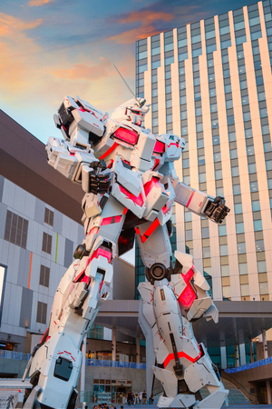 TOKYO, JAPAN - APRIL 20 2018: Full-size Mobile suit  RX-0 Unicorn Gundam replica from the Mobile Suit Gundam Unicorn series at  Diver City Tokyo Plaza - a Shopping mall in Odaiba area