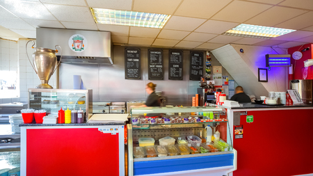 LIVERPOOL, UK - MAY 17 2018: Georgie Porgy a small cafe on Walton Breck Road in front of Anfield stadium serves breakfasts, jacket potatoes, sandwiches, pies and other traditional British grub Editorial