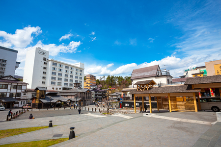 Yubatake Hotspring at Kusatsu Onsen in Gunma  ,JapanGUNMA, JAPAN - APRIL 27 2018: Kusatsu Onsen located about 200 kilometers north-northwest of Tokyo, it is one of Japan's most famous hot spring resorts for centuries 스톡 콘텐츠 - 108015553