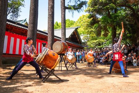 TOKYO, JAPAN - APRIL 29 2018: Unidentified group of women perform Japanese Taiko drum in Bunkyo Azalea Festival (Tsutsuji Matsuri) at Nezu Shrine