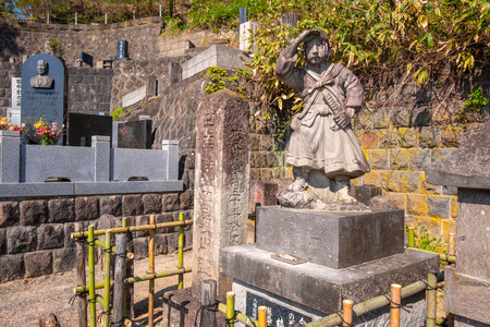AIZUWAKAMATSU, JAPAN - APRIL 21 2018: The grave site of Byakkutai (White Tiger Force) at Mt. Iimori, young teenage samurai who fought and committed suicide in the Boshin war Sajtókép
