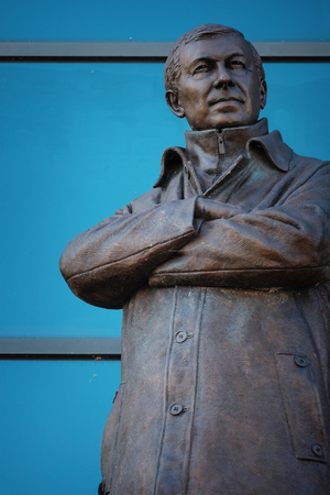 MANCHESTER, UK - MAY 19 2018: Sir Alex Ferguson Bronze statue in front of Alex Ferguson stand at Old Trafford stadium, the Home of Manchester United