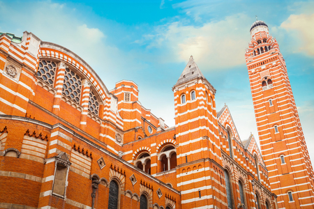 Westminster Cathedral in London, UK  LONDON, UK - MAY 13 2018: Westminster Cathedral or the Metropolitan Cathedral of the Precious Blood of Our Lord Jesus Christ designed by John Francis Bentley and opened in 1903 in neo-Byzantine style