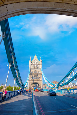 Tower Bridge that crosses River Thames in London, UK London, UK - May 14 2018: Tower bridge crosses the River Thames, its built in 1886 consists of two bridge towers, the bridge deck is freely accessible to both vehicles and pedestrians Editorial