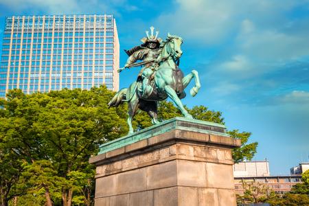 Statue of Kusunoki Masashige, famed Japanese samurai at the East Garden outside Tokyo Imperial Palace Tokyo, Japan - April 28 2018: Statue of the great samurai Kusunoki Masashige, famed Japanese samurai at the East Garden outside Tokyo Imperial Palace