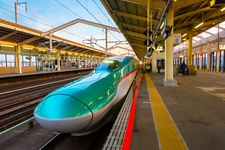 Sendai, Japan - April 21 2018: The Hayabusa is a high-speed Shinkansen service operated by JR East Company use 10-car E5 series sets, which initially operated at a maximum speed of 300 kmh Редакционное