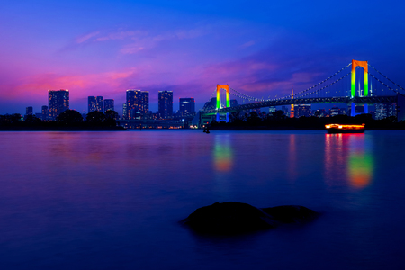 Colorful illuminations at Rainbow Bridge from Odaiba in Tokyo, Japan 写真素材