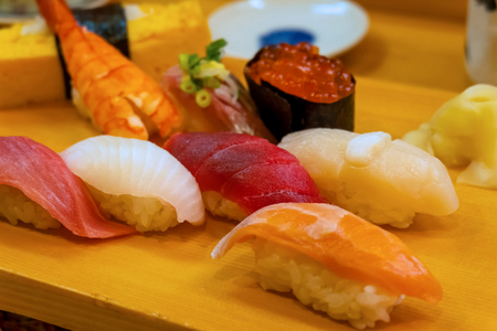 A set of japanese traditional sushi set  beautifully decorated on a wood plate