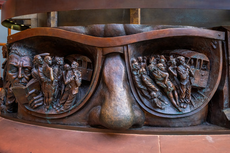 London, UK - May 14 2018: Deatils on the base of The Meeting Place, 9-metre bronze statue revealed in 2007, stands at the south end of the upper level of St Pancras railway station by British artist Paul Day Editorial