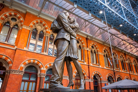 London, UK - May 14 2018: The Meeting Place, 9-metre bronze statue revealed in 2007, stands at the south end of the upper level of St Pancras railway station by British artist Paul Day Editorial