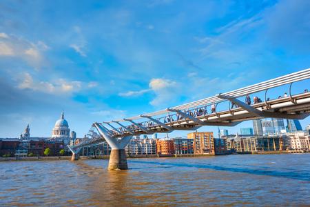 London, UK - May 15 2018: View of St Pauls Cathedral with people crossing the Millenium Bridge (London Millennium Footbridge) Editorial