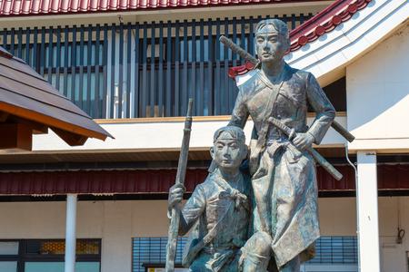 Aizuwakamatsu, Japan - April 21 2018: Statue of young Byakkutai warriors observes the seige of Aizu-Wakamatsu Castle during the battle of Boshin war at Aizuwakamatsu Station
