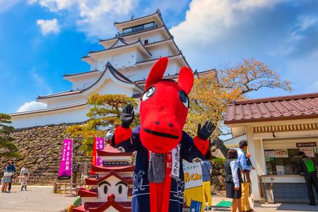 Aizuwakamatsu , Japan - April 21 2018: Unidentified Japanese dresses a Akabeko a legendary cow from the Aizu region mascot suit at Aizu-Wakamatsu Castle Sajtókép