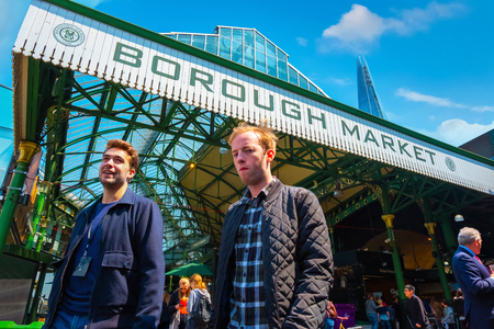 London, UK - May 23 2018: Unidentified people at Borough Market in Southwark, one of the largest and oldest food markets in London, today the market mainly sells speciality foods to the public