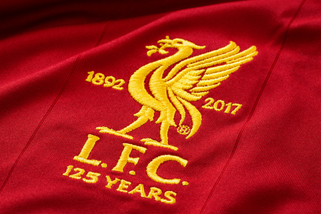 Bangkok, Thailand - January 17 2019: Close-up of Liverpool FC football home jersey circa 2017-2018 with club's emblem, celebrating 125 years of the club Redactioneel